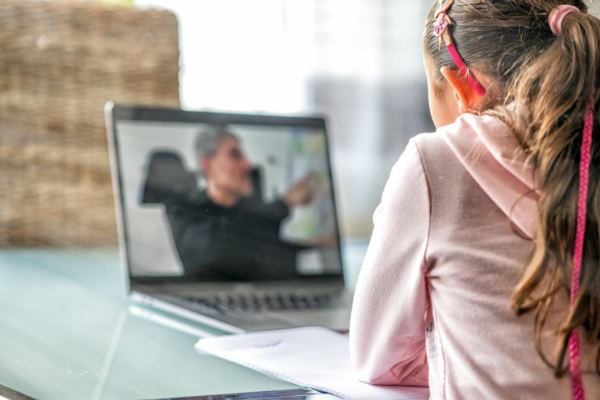 Girl listening online class on the laptop